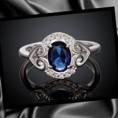 Silver plated sapphire ring Stunning silver plated double heart ring with beautiful sapphire stone. NEW Jewelry Rings