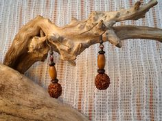 Rudraksha seed with oval wood bead earrings. by ValleyWWKing on Etsy
