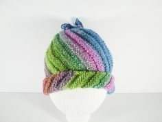 Ravelry: Emergency Hat pattern by Frankie Brown {free}.  Also converts to a cowl - just untie the draw strings.
