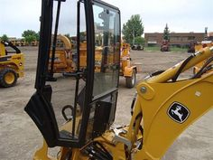 John Deere 110 TLB Backhoe attachment with cab