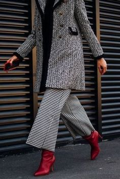 Red boots are great when paired with black and white.. like this matching textured trench and wide leg pant.