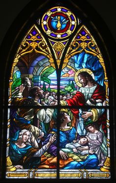 A beautiful stained glass art depicting Jesus healing the sick.