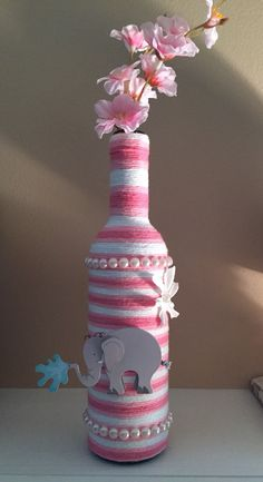 Yarn wrapped wine bottle made by me for a baby shower