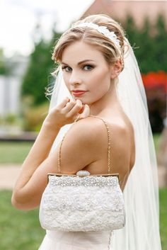 Gorgeous ivory laces and rhinestones are designed onto this beautiful bridal clutch. See more here: http://www.cloenoeldesigns.com