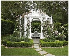 This arbour makes a wonderful focal point. The garden seat is very similar to one made by The Chatsworth Carpenters.