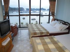 Bed & Breakfast in Ha Long, Vietnam. Situated opposite Halong Bay, Family Hotel is a 10-minute walk from Cat Co 1, 2, and 3 beaches. It offers complimentary Wi-Fi access and rooms with mountain or sea views. The hotel is a 4-minute boat ride from Cat Ba Fishing Village.   Situated op...
