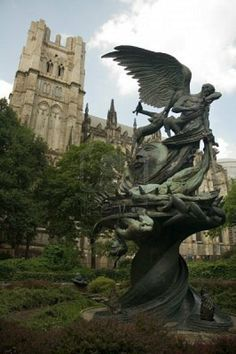 The Peace Fountain in front of the Cathedral of Saint John the Divine  The sculpture depicts the struggle of good over evil. Michael the Archangel defeats Satan.
