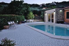 For Sale - Liguria - 1 800 000 euro  This contemporary villa with swimming pool is situated on a large private estate (1700 sqm), surrounded by the scenic hills of Liguria, just minutes from the historical centre and the beaches of Imperia Porto Maurizio. Access to the estate is secured by a convenient private driveway. Interesting location, not isolated, but tranquil and with a lot of privacy.  http://www.househunting-italy.com/property/imperia-liguria-a24/
