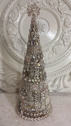 Dying to make this for my bedroom. I would display it on my mirrored dresser. I know I can purchase a form, it is just that the brooches can get expensive quickly. Rhinestone buttons would also work, and are cheaper.
