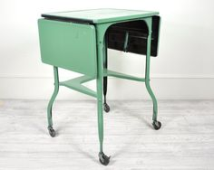 I have a vintage Industrial Metal Typing Table painted in robin eggs blue. $70.00