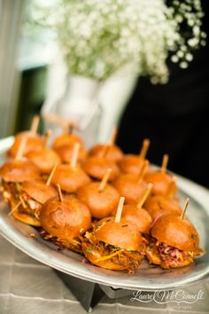Two-bite BBQ pulled pork sliders by Ravishing Radish Catering. Photo by Laurel McConnell Photography.