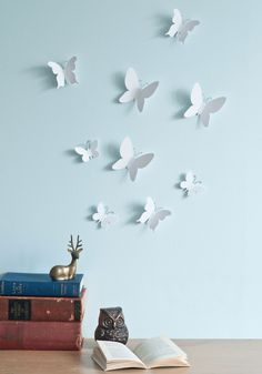 Transform a simple space into a tranquil and inviting environment with this refreshing rabble of butterflies! Crafted from crisp white plastic and completed with distinctly curved wings and curled wire antennas, this majestic display can be mounted to your wall in the flutter of an eye using a small self-adhesive dot. Floating across your room in three proportions, this scenic swarm of nine is essential to your enchanting decor!