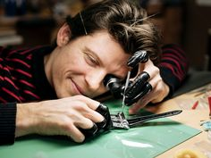 A craftsman attaches a component to a MoonMachine a watch by MB&F and noted Finnish horologist Stepan Sarpaneva with a moonphase display. Swiss Watch Brands, Moon Phases, Craftsman, Rings For Men, Industrial, Display, Watches, Luxury, Artisan