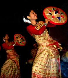 """Bihu Dance Of Assam - The female dancers are called as 'Nachoni'. They are dancing to the rhythmic music played by the male. The beautiful dresses they are wearing are made from the famous """"Golden silk of Assam"""", the dress is locally known as 'Muga r Mekhela Sador"""". This dance is very rhythmic and energetic. It is performed during the Bohag Bihu, the spring festival of Assam."""