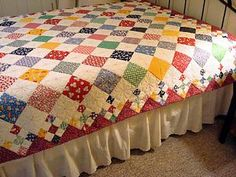Diamond patch quilt. Love the edging.