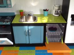 Entertainment Center Turned Play Kitchen | love the water dispenser! It is made from an old baby wipe container ...