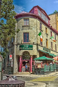 Pub St Patrick, Quebec City, Canada. The enduring symbol of the Irish, hangs high on the wall of a building that dates back to 1749 and was once used to store the ammunition for the town's fortifications. Below the shamrock is the entrance to the Pub St Patrick, its presence standing as witness now to the city's Irish heritage, a heritage that began in the shadow of the Grosse Isle tragedy. http://americanpublichousereview.com/2008.10/quebec/