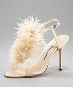 Simply divine! A feathered high heel!