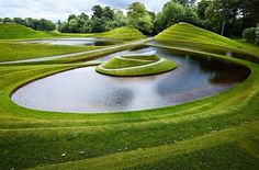 The Garden of Cosmic Speculation in Scotland, designed by Arqhitect Charles Jencks in 1988 and dedicated to Jencks' late wife. The garden is inspired by science and mathematics, with sculptures and landscaping on these themes, such as Black Holes and Fractals.