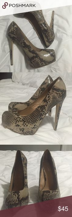 Aldo snake skin pumps Aldo snake skin pumps. Bought at Aldo 3 years ago and only been worn 3 times. Included picture of sole. Size euro 40 Aldo Shoes Heels