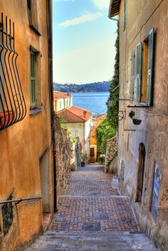 Alleyway in Villefrance-sur-Mer, Provence-Alpes-Côte d'Azur. Had a wonderful day in this little town years ago. Not sure I could navigate these streets now!!