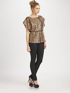 Alice and Olivia.  Whether she's 8 or 80, very girl should own a sequin top.