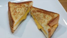 Two grilled cheese sandwich halves on a white plate. Perfect Grilled Cheese, Different Types Of Bread, Homemade White Bread, Grill Cheese Sandwich Recipes, Sweet Cornbread, Recipe Please, Slice Of Bread, Melted Cheese, Cheddar Cheese