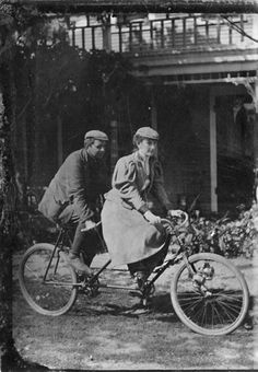 Mae Sawyer Stibgen rides a tandem bicycle with an unidentified man on an outing with the Lincoln Cycling Camera Club in Half Day, Illinois, c. September 20, 1896. Photographer unknown.
