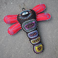 Mexican folk art-inspired Embroidered Cyclops Dragonfly by Sylvia Windhurst. love the glued-on doll's eye