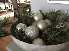 mother of pearl bowl with christmas greens and pewter baubles