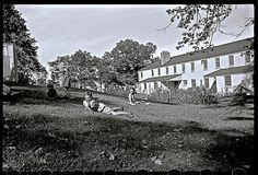 Life in gardens/enclosure: children on grass in planned garden village of Greendale, WI, in 1939, by John Vachon, via Library of Congress.
