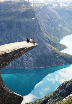 Trolltunga Norway. I highly doubt you'd get me sitting on the edge like that, but it'd sure be amazing to be there.
