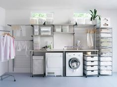 Ikea's organization system comes with adjustable shelves, a folding table, drying bars, moveable clothing racks and hampers that create an airy space.