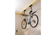 Pulley System for Garage Storage . Pulley System for Garage Storage . 903 705 5600 the attic Lift Utilize Your attic Space for Bike Storage Garage Ceiling, Bike Storage Rack, Garage Shelving, Shelving Ideas, Bike Storage Pulley System, Wall Storage, Bike Hanger For Garage, Storing Bikes In Garage, Bike Wall