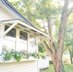 The couple built a window box with whimsical scalloped edges. To protect seedlings from the blistering sun, they also installed an awning. The self-described black thumbs were able to keep the blooms going strong all season. Farmhouse Windows, Cottage Farmhouse, Modern Farmhouse, Farmhouse Style, Kitchen Windows, Window Awnings, Outdoor Awnings, House Tours, Instagram