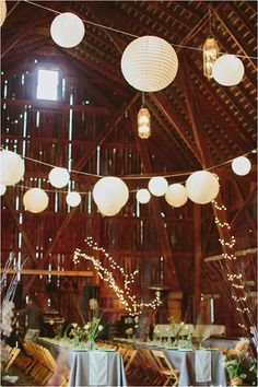 Hosting your wedding in a barn? Decorate the tall, bare ceilings with paper lanterns from the dollar store.
