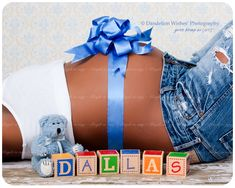 All kinds of cute maternity photos, this is cute even small bellied with bow announcing the date/pregnancy announcement/gender.