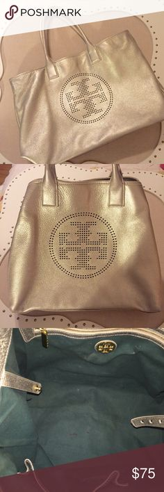 Tory Burch Metallic Tote Preloved. Used the bag for two years. Pen marks inside. Three small cracks in handles that are not visible when holding the bag/the bag is closed. Otherwise, the bag is in great condition and will make a great addition to someone's closet. Tory Burch Bags Totes