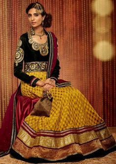 Genuine Splendor Comes Out As A Outcome Of The Dressing Style And Design<br>With This Black and Yellow Faux Georgette Kimora Anarkali Suit<br>This Enticing Dress Is Displaying Some Fantastic Embroidery Done<br>With Lace Work,Multi Work,Patch Work,Resham Work,Stones Work.