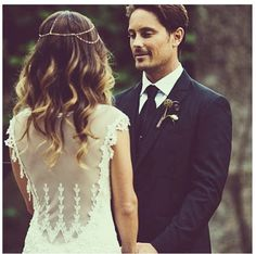 love the lace, sheer back and little detail on the shoulders. also love the headpiece... and the groom looks great too! i love this natural look.