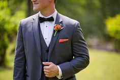 Groom's boutonniere: tangerine rosebud. Pop! | Victoria Belle Mansion and Vintage White Barn, GA | Megan Hobbs Photography