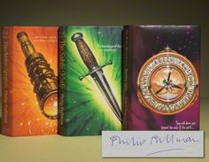 His Dark Materials Trilogy-oh my goodness, first editons with signature *tries to reach into the screen, hits glass disappointingly*