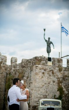 Bride and groom in front of castle of Nafpaktos