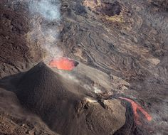 Photo by @christopheviseux // The volcano Piton de la Fournaise (2,632m / 8,635 ft.) recently erupted on La Réunion Island. In order to appreciate this fascinating show, helicopter flights are available and offer the best view point and photo opportunities. La Réunion Island is an overseas French department and is located in the Indian Ocean, east of Madagascar. About 40% of the island has been declared a UNESCO World Heritage Site. Follow me @christopheviseux for more adventures. #volcano…
