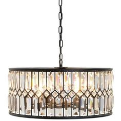 Lighting - Create an elegant, sophisticated look with this chandelier featuring a drum-shaped shade full of clear glass crystals, which create a lovely sparkling effect when the chandelier is lit. This iron-framed fixture has a neutral bronze finish that suits most color schemes, particularly warm or neutral tones. This chandelier's transitional style complements traditional and contemporary decor.