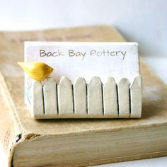 Little bird on a white picket fence ceramic business card holder little bird on a white picket fence ceramic business card holder light yellow reheart Images