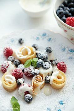 Crepe Strips, Fruit & Yogurt  - Sprinkle w powdered sugar.  Lovely way to present crepes.