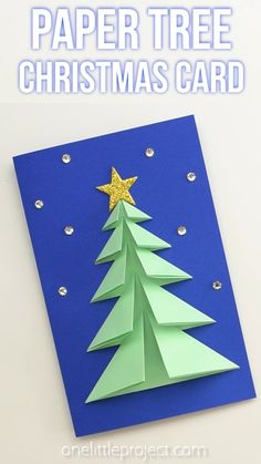 This 3D paper Christmas tree card is SO PRETTY and it's so simple to make! Grab the free printable template to make these easy and beautiful homemade Christmas cards. This is such a great Christmas craft and a super fun holiday craft for kids.