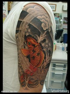 Koi Fish sleeve tattoo - brilliant orange on a monotone background