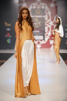 This white #patiala pant with #golden slit top, fulfills the luxury desire of a #princess